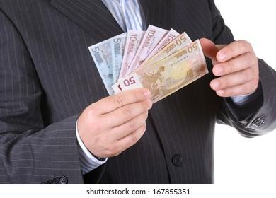 Businessman counts money euro