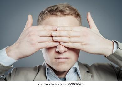 Businessman Covering Eyes Isolated On Grey Background