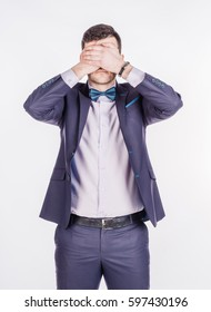 businessman covering his eyes with his hand. emotions, facial expressions, feelings, body language, signs. image on a white studio background.