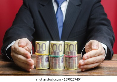 Businessman covers with hands euro money protection gesture. Provision money, credit, grant. Project financing. Payment purchases, profits dividends. Business investment. Financial social assistance