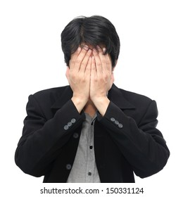 Businessman covers his face with hands