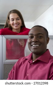 Businessman and co-worker in cubicles