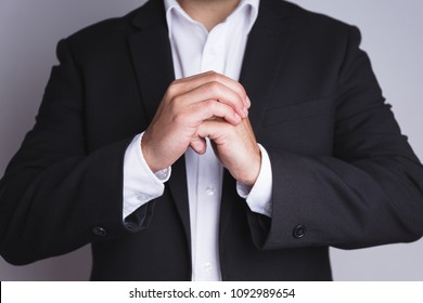 Businessman cracking fingers.