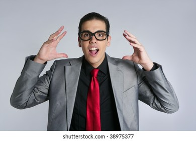 Businessman crazy with funny glasses and suit on gray background