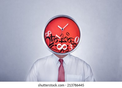 Businessman with a creative clock which imitates his head. Bad organization and time management concept.