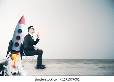 Businessman with creative launching rocket. Start up and growth concept.