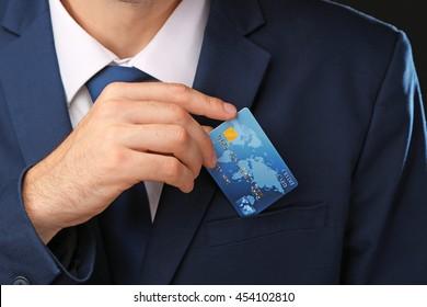 Businessman with credit card, closeup