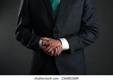 Businessman with a crossed arms on a gray background. Business acumen. Strict boss.
