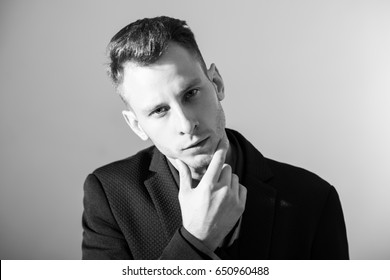 businessman with crossed arms pose against grey background