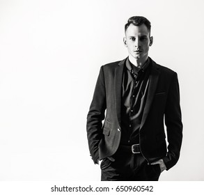businessman with crossed arms pose against white background