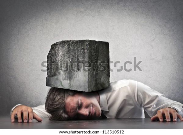 Businessman crushed by a boulder