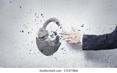 Businessman crushing stone lock with finger touch