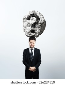 businessman crying with big rock on head