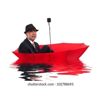 Businessman crying while floating on umbrella