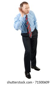 Businessman cups his hand to his ear to hear better, isolated on white