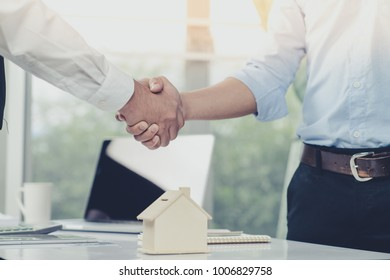 Businessman and customer had shake hand for achieve target means together and signed in the contract of sale of real estate