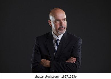 businessman in dark blue suit looking serious