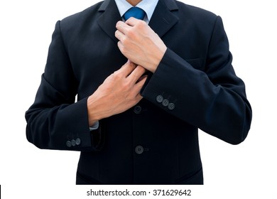Businessman in dark gray suit rearrange his neck tie for new opportunity, new life, new success