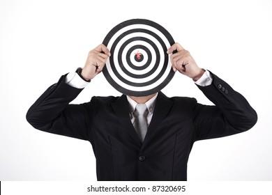 Businessman with a dart in bull's eye