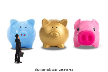 Businessman decision for investment his business with depoit money with three type piggy bank.