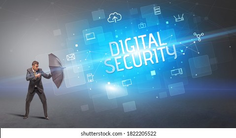 Businessman defending with umbrella from cyber attack and DIGITAL SECURITY inscription, online security concept
