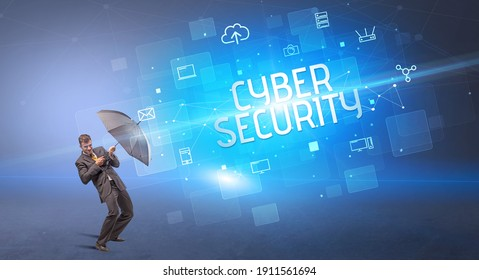 Businessman defending with umbrella from cyber attack and CYBER SECURITY inscription, online security concept