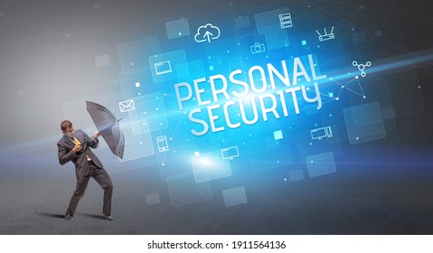 Businessman defending with umbrella from cyber attack and PERSONAL SECURITY inscription, online security concept