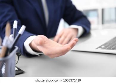 Businessman demanding bribe indoors, closeup