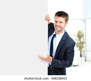 Businessman demonstrates the project to the potential customer and smiling