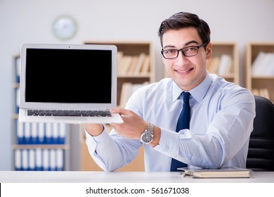 Businessman demonstrating the screen of laptop