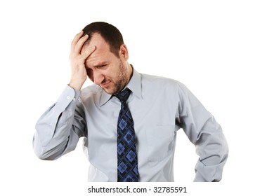Businessman in depression with hand on forehead, isolated over white