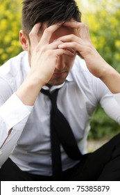 Businessman in depression with hands on forehead