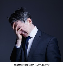 Businessman in depression. Problems with Business Process Management (Difficulty, corruption, fiction, bankruptcy concept)