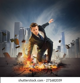 Businessman determined breaks the asphalt with force