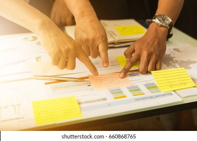businessman develop plan and make strategy for invest in global market ; business teamwork review and analyse information report of economic investment at office