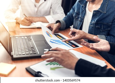 Businessman  discussing or brainstorming something positive in the meeting.Explanation solution and analysis the data to be success team.Teamwork people concept.