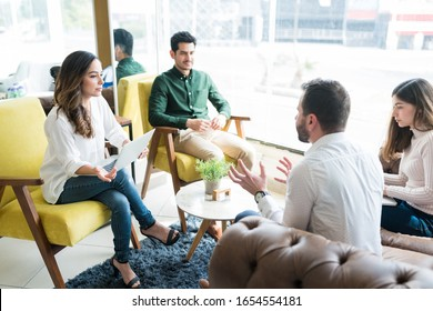 Businessman discussing with colleagues in meeting at office