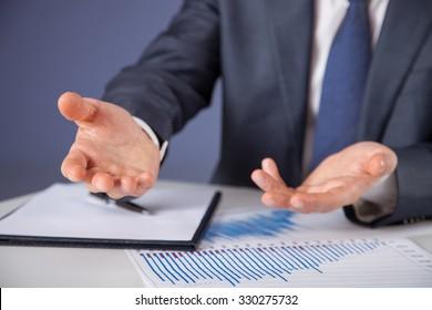 Businessman discussing at work place, dark background