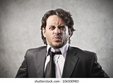 Businessman with disgusted expression