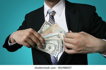 Businessman Displaying a Spread of Cash
