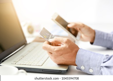 businessman do online shopping with credit card and mobile phone, internet banking