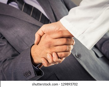 Businessman and doctor shaking hand's.
