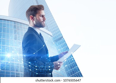 Businessman with document standing on abstract city background with forex chart and copy space. Trade and analysis concept. Double exposure