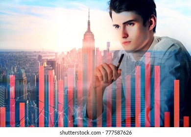 Businessman doing paperwork at workplace with abstract city view and digital business chart bars. Financial growth and profit concept. Double exposure
