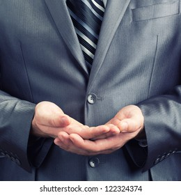 Businessman doing two palms together gesture