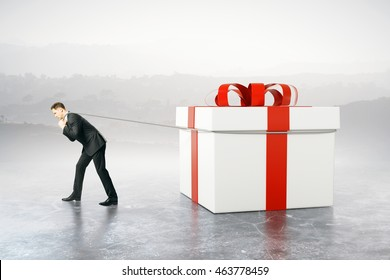 Businessman dragging huge present box on abstract background. 3D Rendering