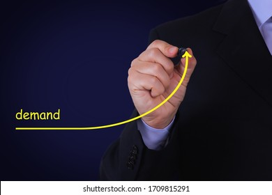 Businessman draw growing line symbolize growing Demand. Business, Technology, Internet and network concept.
