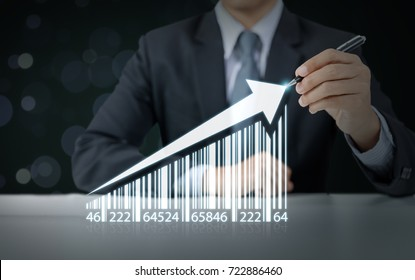 businessman draw increasing graph with barcode, business growth