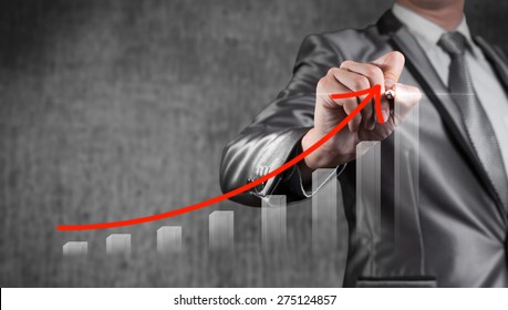 Businessman draw red curve with bar chart, business strategy concept