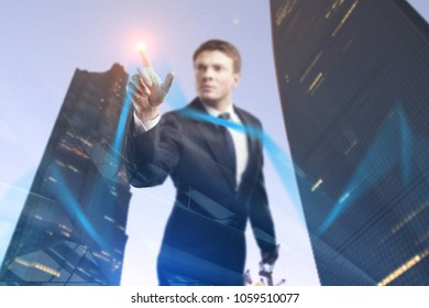 Businessman drawing business chart line on abstract city background. Finance and success concept. Double exposure
